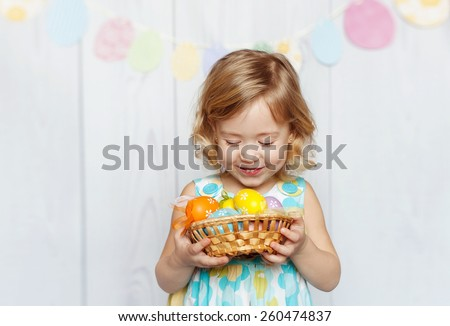 Happy girl holding Easter basket - stock photo