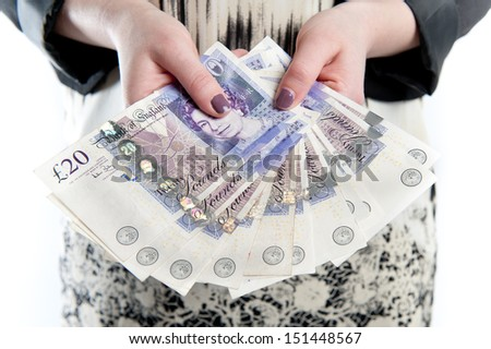 Happy girl holding fan of cash on white isolated background - stock photo