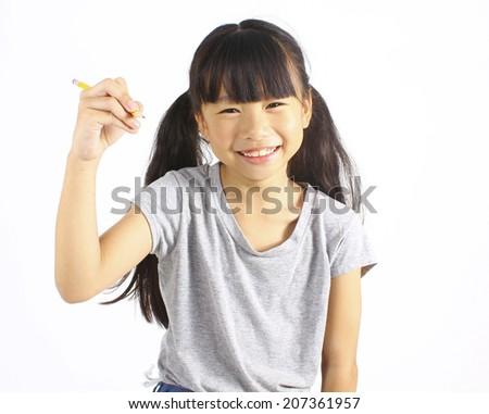 Happy girl holding pencil - stock photo