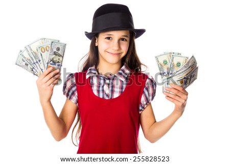 Happy girl in black hat with hundreds of dollars in hands, isolated on white - stock photo