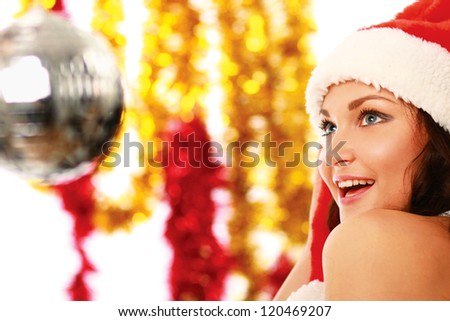 Happy girl in santa hat isolated on white background - stock photo