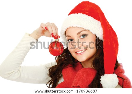 Happy girl in santa hat with christmas ball isolated on white background - stock photo