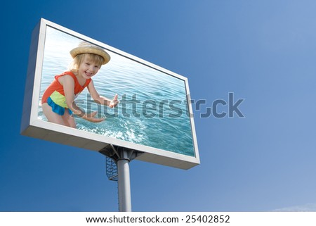 happy girl in sea on the board advertisement under blue  sky - stock photo