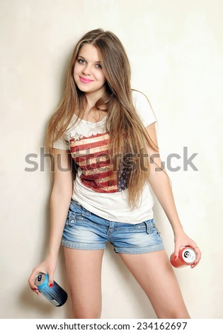 Happy girl in t-shirt and jeans with drinks - stock photo