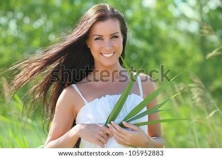 happy girl in white dress in the grass - stock photo