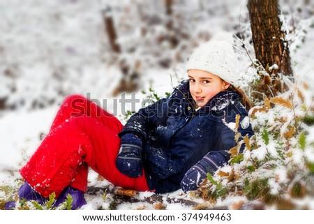 Happy girl in winter time - stock photo