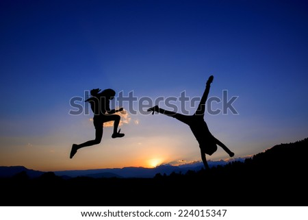 Happy Girl Jumping On - stock photo