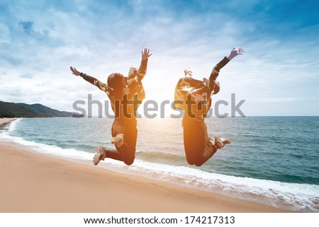 Happy girl jumping on the beach on the - stock photo