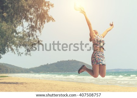 Happy girl jumping on the beach with vintage tone -motion  blur - stock photo