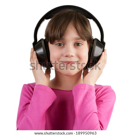 Happy girl listening to music on headphones - stock photo