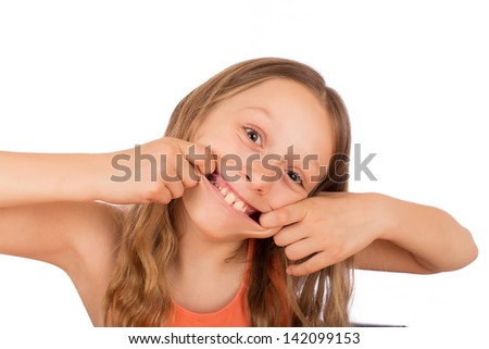 Happy girl make a grimace. Isolated on a white background. - stock photo