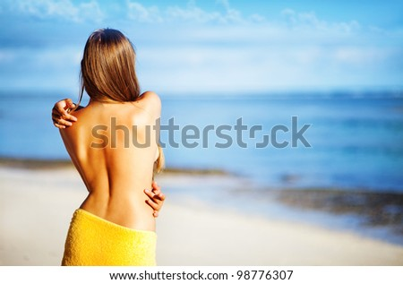 happy girl near swimming pool, bali resort hotel - stock photo