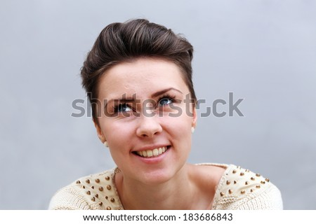 Happy girl on a grey background - stock photo