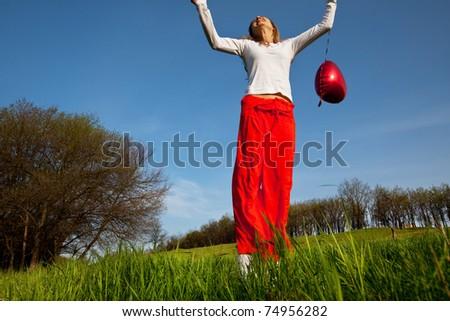 Happy girl on grassland - stock photo