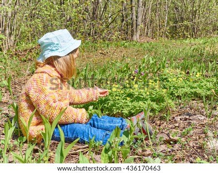 Happy  girl on the meadow with yellow flowers. - stock photo