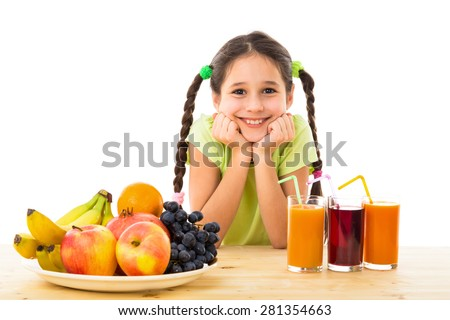 Happy girl on the table with fruits and juice, isolated on white - stock photo