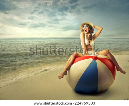 Happy girl playing at the beach  - stock photo