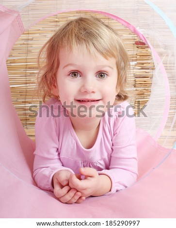 Happy girl playing in her little children house.  - stock photo