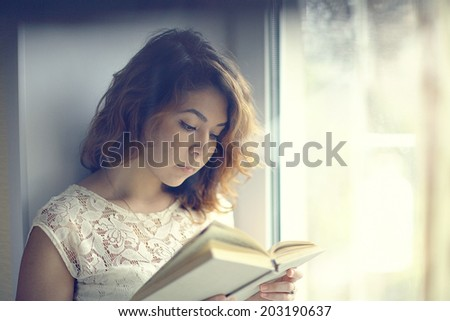 happy girl reading the morning - stock photo