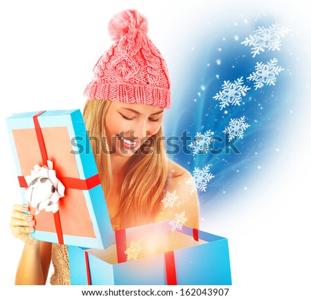 Happy girl receive Christmas present, opened big gift box, many magical snowflake flying from box, fantasy New Year surprise - stock photo
