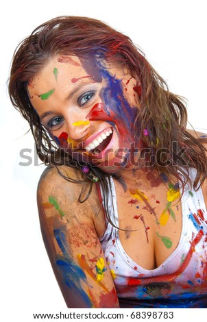 Happy girl, she is all smeared in paint - stock photo