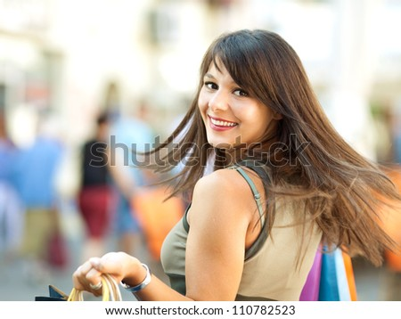 Happy girl shopping in the city - stock photo