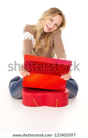 happy girl sitting near the gift boxes - stock photo