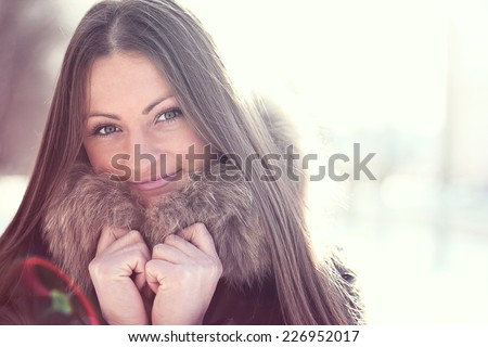 Happy girl smiling in winter - stock photo