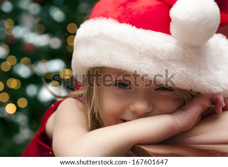Happy girl waiting Christmas present at home  - stock photo
