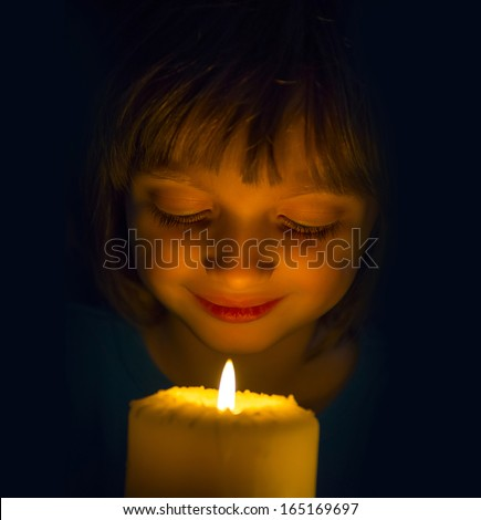 happy girl with a candle - stock photo