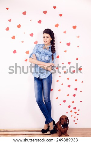 happy girl with a dog dachshund against the background of the heart.   International Women's Day, Valentine's Day, March 8, Mother's Day - stock photo