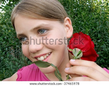 Happy girl with a red rose - stock photo