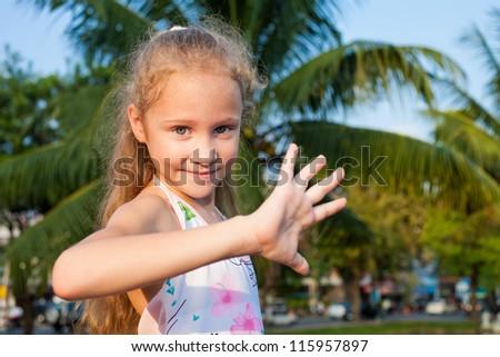 happy girl with arm raised - stock photo