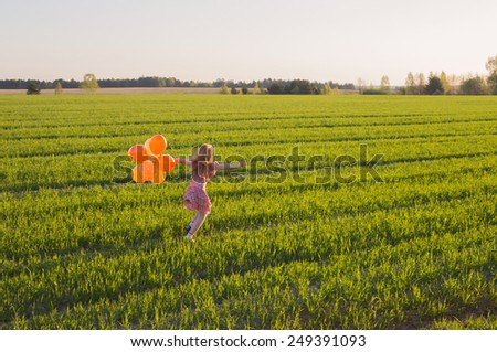 happy girl with balloons outdoor - stock photo