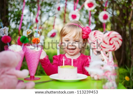 happy girl with birthday cake outdoors - stock photo