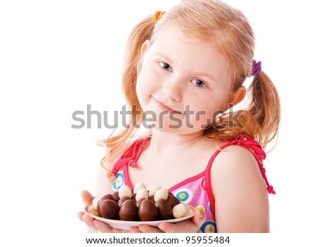 happy girl with chocolate eggs - stock photo