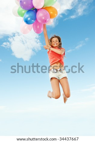 Happy girl with colorful balloons - stock photo