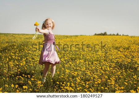 happy girl with dandelion outdoor - stock photo