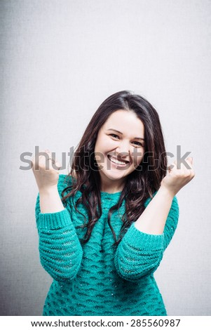 happy girl with fists - stock photo
