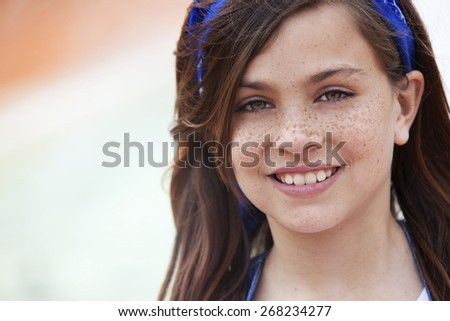 Happy girl with freckles portrait - stock photo