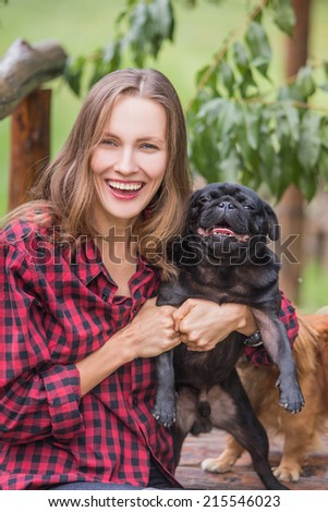 Happy girl with her dog in the park - stock photo