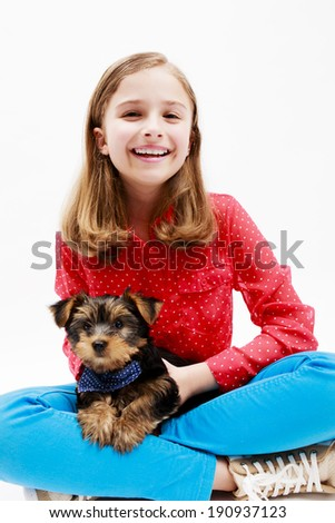 Happy girl with puppy, cute Yorkshire terrier  - best friends - stock photo
