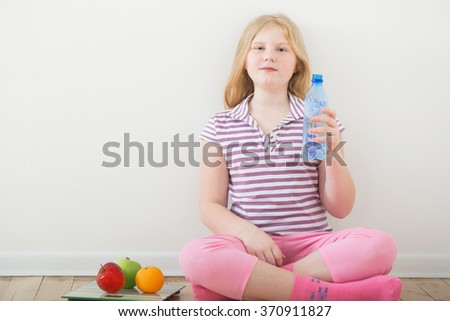 happy girl with scales and fruits - stock photo
