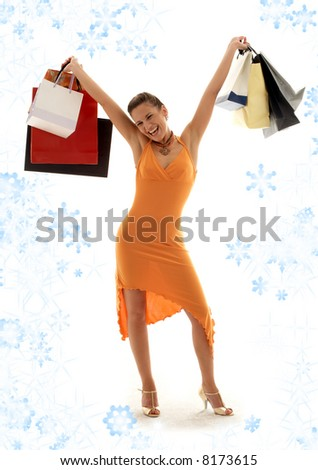 happy girl with shopping bags and snowflakes - stock photo