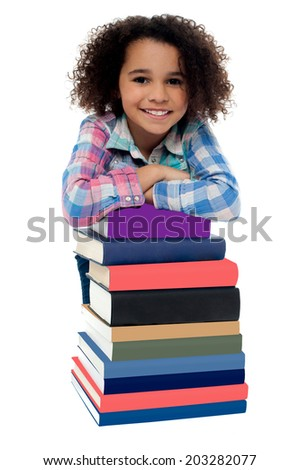 Happy girl with stack of textbooks - stock photo