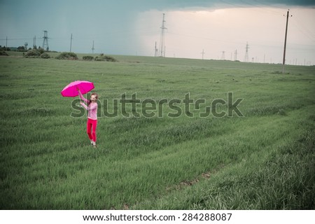 happy girl with umbrella outdoor - stock photo