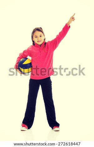 Happy girl with voleyball ball - stock photo