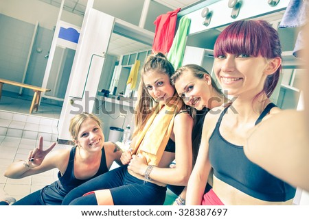 Happy girlfriends group taking selfie in gym dressing room - Sporty female friends ready for fitness time - Healthy lifestyle and sport concept in training center - Bright vintage desaturated filter - stock photo