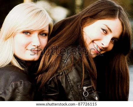 Happy girlfriends outdoors - stock photo