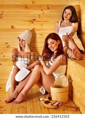 Happy girlfriends relaxing in sauna. - stock photo